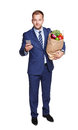 Businessman with healthy food, grocery buyer isolated Royalty Free Stock Photo