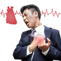 Businessman heart attack in isolated on white background Stock Photos
