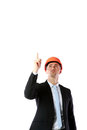 Businessman in helmet pointing up at copyspace Royalty Free Stock Photo