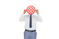 Businessman hiding his face behind a red target on white background Stock Photos