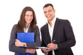Businessman and his young secretary with notes successful smiling Stock Photography