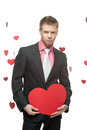 Businessman holding big red heart caucasian young in gray suit sign in form of with sexy look Stock Photography