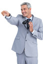 Businessman holding binoculars and pointing out something on white background Royalty Free Stock Photo