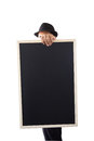 Businessman holding a blackboard in hands Stock Photography