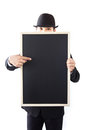 Businessman holding a blackboard in hands Stock Image
