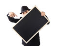 Businessman holding a blackboard in hands Stock Photo