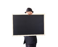 Businessman holding a blackboard in hands Royalty Free Stock Image