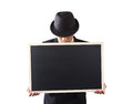 Businessman holding a blackboard in hands Stock Photos