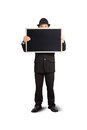 Businessman holding a blackboard in hands Royalty Free Stock Images