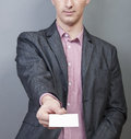 Businessman holding blank card an image of businessmen Royalty Free Stock Photo