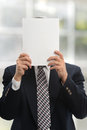 Businessman holding a blank paper Royalty Free Stock Photo