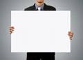 Businessman holding blank sign and hand Royalty Free Stock Images