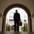 Businessman holding briefcase. Royalty Free Stock Photo