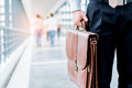 Businessman holding a briefcase travellers walking outdoors Royalty Free Stock Photo