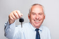 Businessman holding car key portrait of smiling Stock Photos