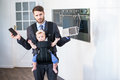 Businessman holding cellphone and laptop while carrying daughter Royalty Free Stock Photo