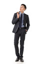 Businessman holding a cigar attractive young asian full length portrait isolated on white background Stock Photo
