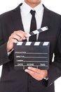 Businessman holding clapper board close up of a in suit Stock Photos