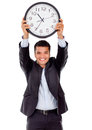 Businessman holding a clock Royalty Free Stock Images