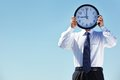 Businessman holding a clock Royalty Free Stock Photo