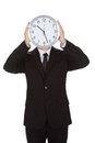 Businessman holding clock over the face Stock Images
