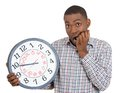 Businessman holding clock pressured by lack of time Stock Photography
