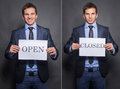Businessman holding closed and open signs young Royalty Free Stock Photo