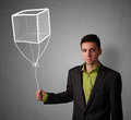 Businessman holding a cube balloon young drawn Royalty Free Stock Photos