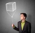 Businessman holding a cube balloon young drawn Stock Photos