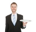 Businessman holding empty tray over white background Royalty Free Stock Photo