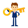 Businessman Holding Golden Key To Success Royalty Free Stock Photo