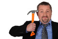 Businessman holding a hammer Royalty Free Stock Photo