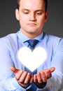 Businessman is holding heart caucasian in hands Stock Images