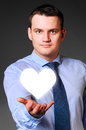 Businessman is holding heart caucasian in hands Stock Photos