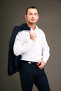 Businessman holding his jacket over shoulder Royalty Free Stock Photo