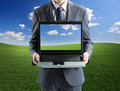 Businessman holding his laptop Royalty Free Stock Photo