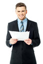 Businessman holding important deal documents executive of an Stock Photography