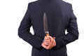 Businessman holding knife behind his back business man Stock Photography