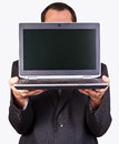 Businessman holding a laptop Royalty Free Stock Photo