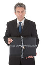 Businessman holding laptop with chain and lock Stock Image