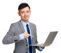 Businessman holding laptop and finger pointing to screen