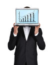Businessman holding laptop in tuxedo wirth business chart Royalty Free Stock Image