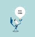 Businessman holding light bulb in his hand ,get the big idea
