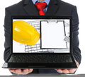 Businessman holding an open laptop isolated on white background Royalty Free Stock Photos