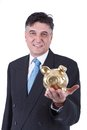 Businessman holding a piggy bank Royalty Free Stock Photos