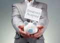 Businessman holding piggy bank for charity donation box fundraising investment or venture capitalist loan Royalty Free Stock Image