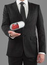 Businessman holding pills with dollar symbol Royalty Free Stock Photography