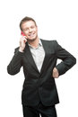 Businessman holding pink cell phone Stock Photography