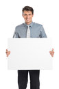 Businessman holding placard sign portrait of happy young blank isolated on white background Royalty Free Stock Photo