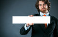 Businessman holding a rectangular blank sign Royalty Free Stock Photo